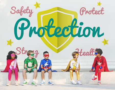Children in superhero costumes with protection concept Stock Photo