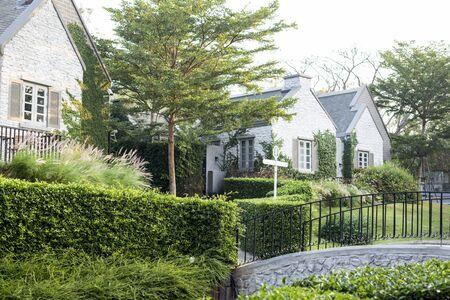 suburban: Upscale suburban house with garden and bridge