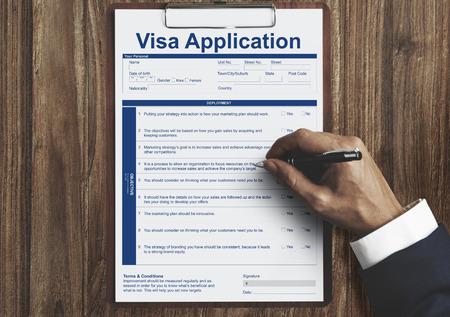 Man filling up visa application