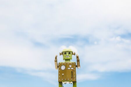 retro styled: Robot Toy Imagination Retro Styled Cloudscape Sky Concept Stock Photo