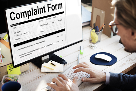 Monitor with complaint form Stockfoto