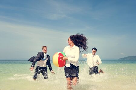 coworker: Business People Fun Playing Beach Travel Concept