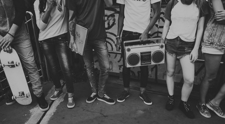 Young people holding a boombox and vinyl record