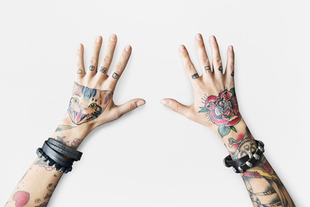 Hands with tattoos Foto de archivo - 111629591