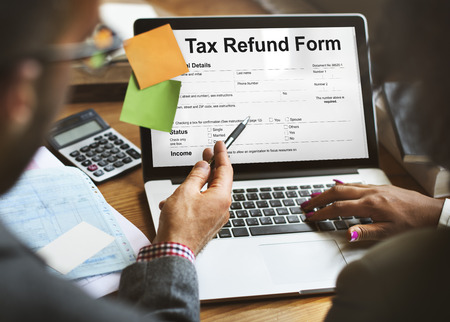 Laptop with tax refund form
