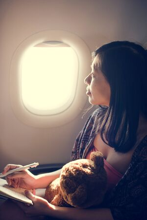 reading and writing: Woman Reading Writing Book Plane Concept