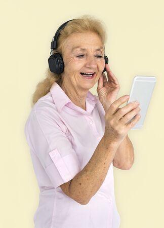 Senior Adult Use Mobile Headphone Concept Stock fotó