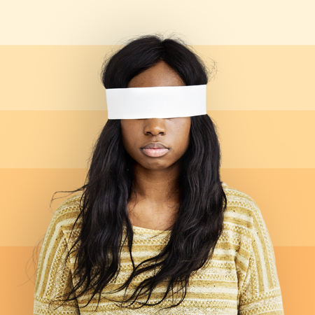covering eyes: African Descent Woman Covering Eyes Concept Stock Photo