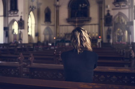 grieve: Woman Sitting Church Religion Concept