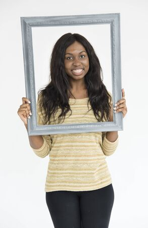 descent: African Descent Holding Frame Smiling Concept Stock Photo
