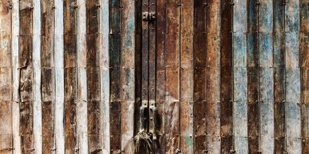 metalic texture: Old Rusty Folded Door Gate Old fashion Concept