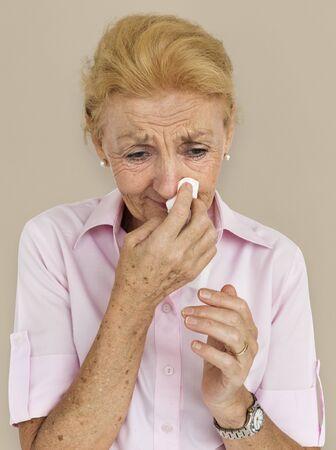 blowing nose: Senior Women Blowing Nose Concept