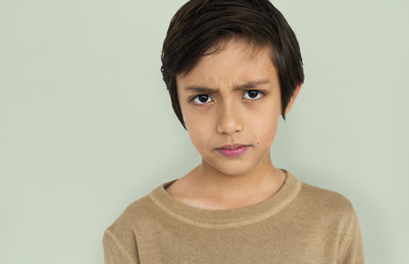 mournful: Little Boy Frowning Sad Concept