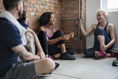 active adult community: Yoga Practice Exercise Class Concept Stock Photo