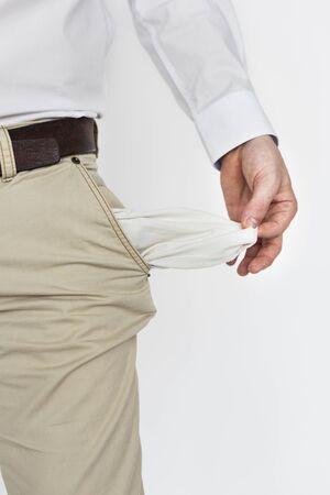 moneyless: Male Shows Empty Pockets Moneyless Concept
