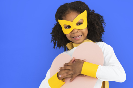 Girl with a mask and heart shaped paper Banco de Imagens