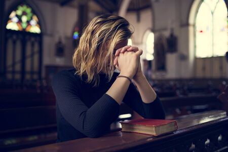 personal god: Woman Sitting Church Religion Concept