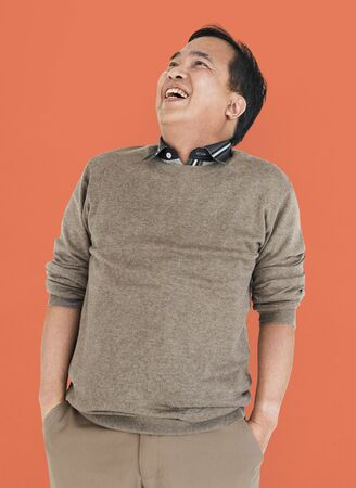 to lean: Asian Man Lean Back Laughing Concept Stock Photo