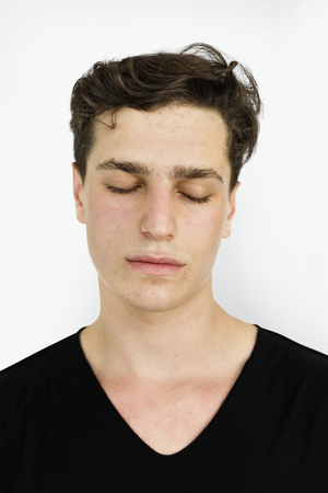 Young man closing his eyes