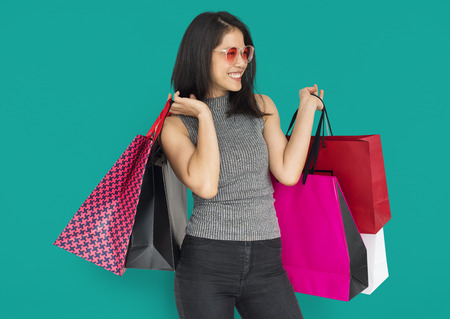 Happy woman with shopping bags 写真素材 - 111669549