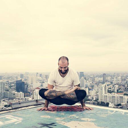 exersice: Man Practice Yoga Rooftop Concept
