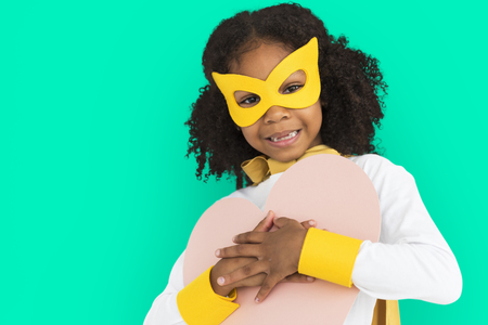 Masked girl with heart shaped paper
