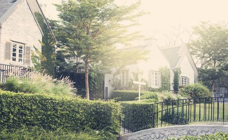 upscale: Upscale suburban house with garden and bridge