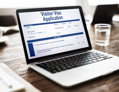 Visitor visa application concept on laptop screen Stock Photo