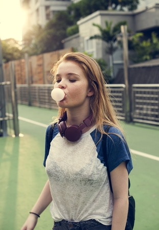 Girl Blowing Bubble Gum Cheerful Lifestyle Concept