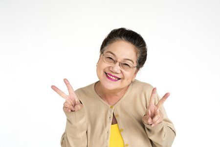 Senior woman gesturing peace signs