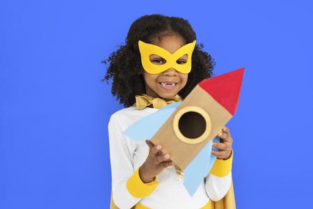 Masked girl with paper rocket ship Stockfoto - 112007712
