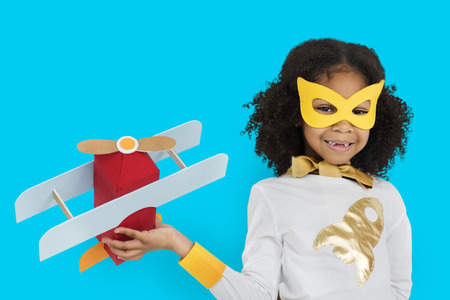 Masked girl with paper airplane