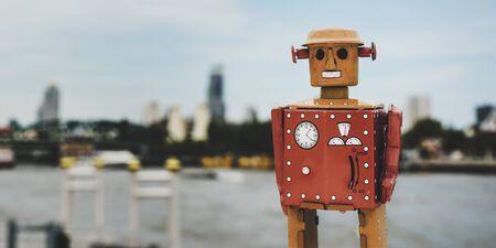 tin robot: Retro tin robot toy city background Stock Photo