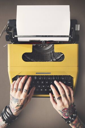 adult  body writing: Tattoo Typewriter Machine Letter Journalism Concept