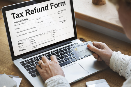 Tax refund form concept on laptop screen