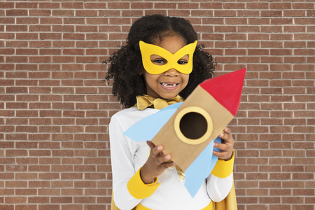 Masked girl with paper rocket ship 版權商用圖片