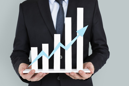Businessman holding success growth graph