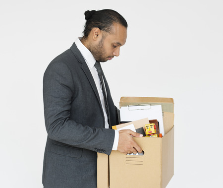 Businessman packing up his items Фото со стока