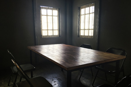 Dark small room with table and chair