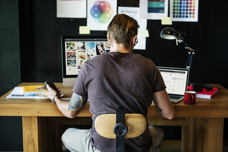home office: Man Busy Photographer Editing Home Office Concept