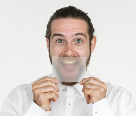 cover mouth: Man Holding Paper Cover Mouth Concept