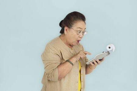 thinking machines: Senior Adult Women Hold Calculator Concept