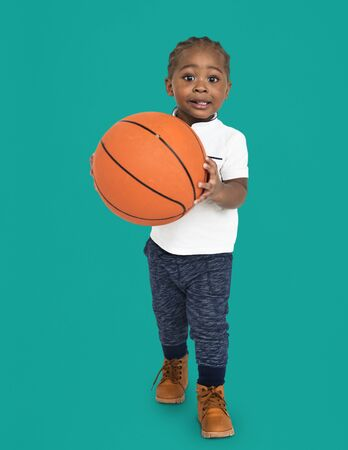 Little Kid With Basketball Concept Stock Photo