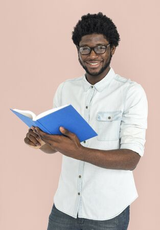 enrich: African Descent Holding Book Concept Stock Photo