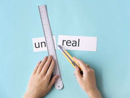 Unreal Hands Cut Word Split Concept Stock Photo