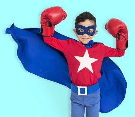 unafraid: Boy Superhero Brave Child Gutsy Kid Concept Stock Photo