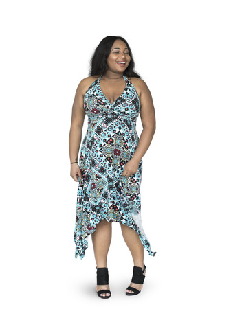 Woman in a dress is smiling
