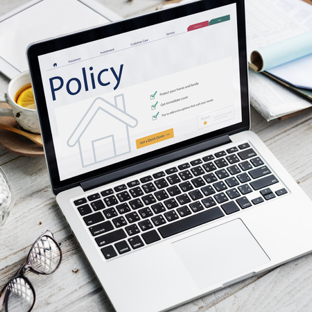 Laptop with house policy concept