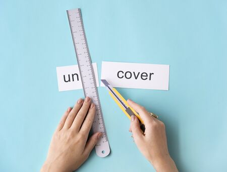 uncover: Uncover Hand Cut Word Split Concept Stock Photo