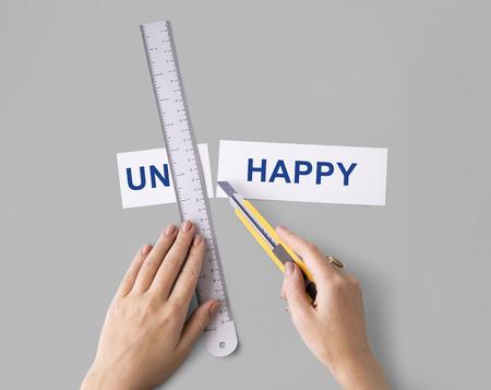 Unhappy Sadness Hand Cut Word Split Concept Stock Photo